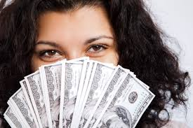image of woman holding money